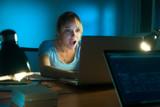 Fototapety Woman Watching Shocking Message On Social Network Late Night
