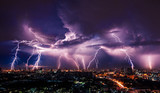 Fototapety Lightning storm over city in purple light