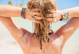 Blonde woman with sandy hair by the beach - 84092189