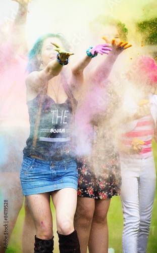 Foto op Canvas Bedehuis Two girl during Holi festival throw color paints