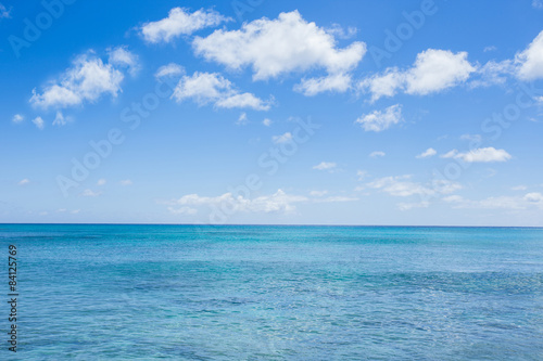 seascape with clouds and blue sky background