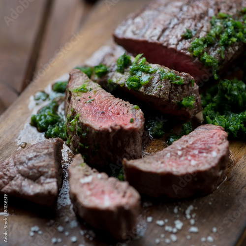 Poster Medium rare grilled beef barbecue steak with chimichurri sauce