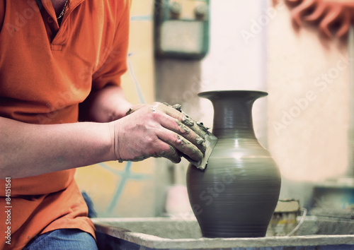 People at work: the production of ceramic vases on a Potter's wh Poster