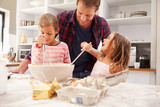 Father baking with children