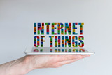Internet of things (IoT) concept with text and tablet poster