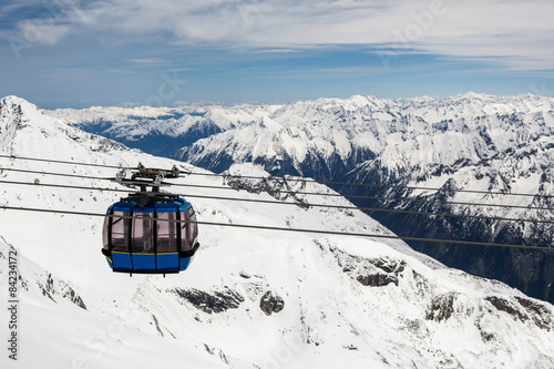 Poster Heuvel Cable car with ski slope in mountains near Zillertaler Alps