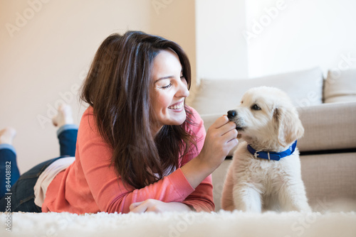 Poster Woman with puppy