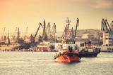 Fototapeta Tug boats are working in Varna harbor. Black Sea