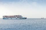 Fototapeta Passenger boat full of people goes in Izmir, Turkey