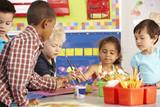 Fototapety Group Of Elementary Age Schoolchildren In Art Class