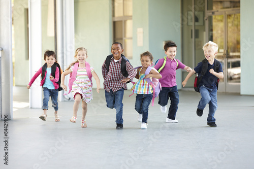 Poster Group Of Elementary Age Schoolchildren Running Outside