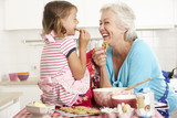 Fototapety Grandmother And Granddaughter Baking In Kitchen