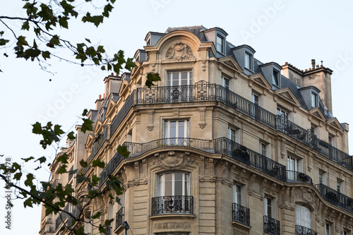 Poster corner of of typical house with balcony in Paris, France