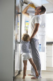 Father And Son Raiding The Fridge For Drink poster