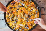 Eating mixed paella