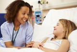 Nurse Sitting By Young Girl
