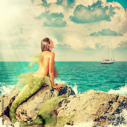 Fototapeta Mermaid sitting on rocks