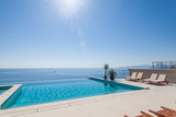 Fototapety Luxury swimming pool and blue water