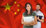 Fototapety Couple of students over chinese flag