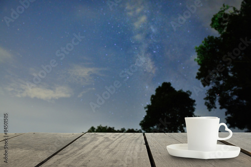Defocus with terrace wood and cappuccino coffee with Milky way Poster