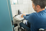 Fototapety Man On Wheelchair Washing Hands