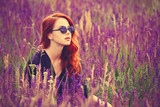 Fototapety girl with sunglasses on lavender field.