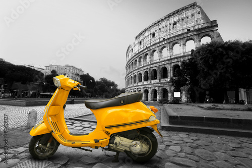 Yellow vintage scooter on the background of Coliseum Poster
