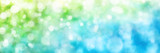 Fototapety Defocused highlights in green and blue, panorama format