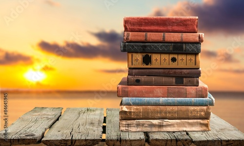 Books, old, stacked. - 84645945