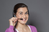 welcoming 30s female representative answering the phone with earphones poster