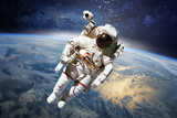 Astronaut in outer space with planet earth as backdrop. Elements - Fine Art prints