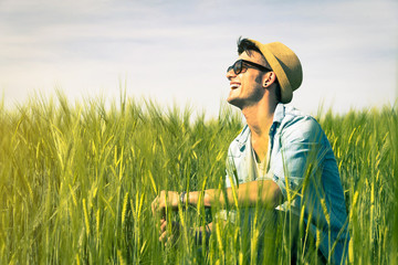 Guy is smiling in the countryside - Emotions, lifestyle and people concept