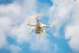 Professional planning copter flying against the sky poster
