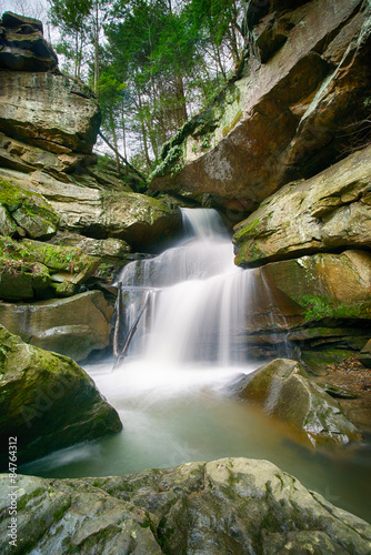 Plakat Waterfall over Tall Boulders