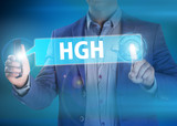 Businessman presses button hgh on virtual screens. Business, tec