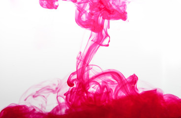pink ink spread in water © zhu difeng