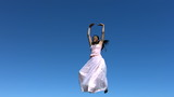 Woman in dress spins, slow motion
