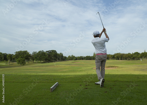 Fototapeta widely golf course in very nice day in summer with player
