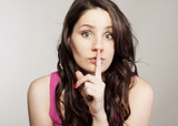 Young woman saying shh