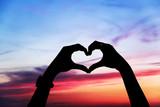 Heart shape of hands against the sky - Fine Art prints