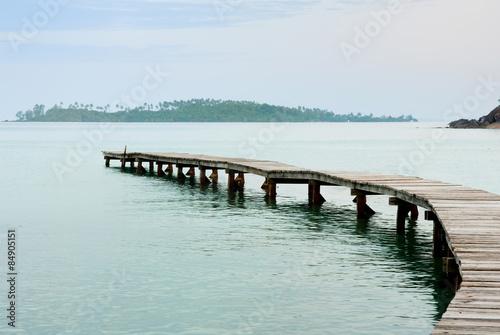 Fototapeta Beautiful seascape in morning time with wood bridge into sea
