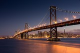 Fototapety Dusk over San Francisco-Oakland Bay Bridge and San Francisco Skyline. Yerba Buena Island, San Francisco, California, USA.