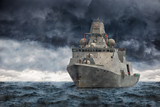 The military ship on sea against heavy clouds.