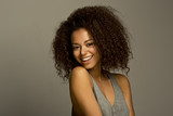 Fototapety Portrait of a beautiful natural young African woman smiling happiness