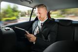 Fototapety Businessman Using Digital Tablet