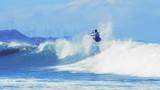 Freestyle acribatic trick on sea wave by kitesurfer. Adrenaline sport slowmo poster