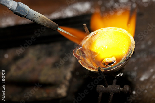 Melting silver in a jewelry workshop © homonstock