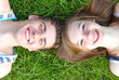 Young happy couple lying in grass