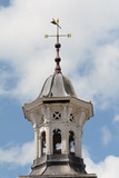 Tower with weather vane on top in Old Market Square, Hitchin, Hertfordshire poster