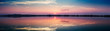 Perfectly specular reflection on the salt pans at sunset - panoramic view